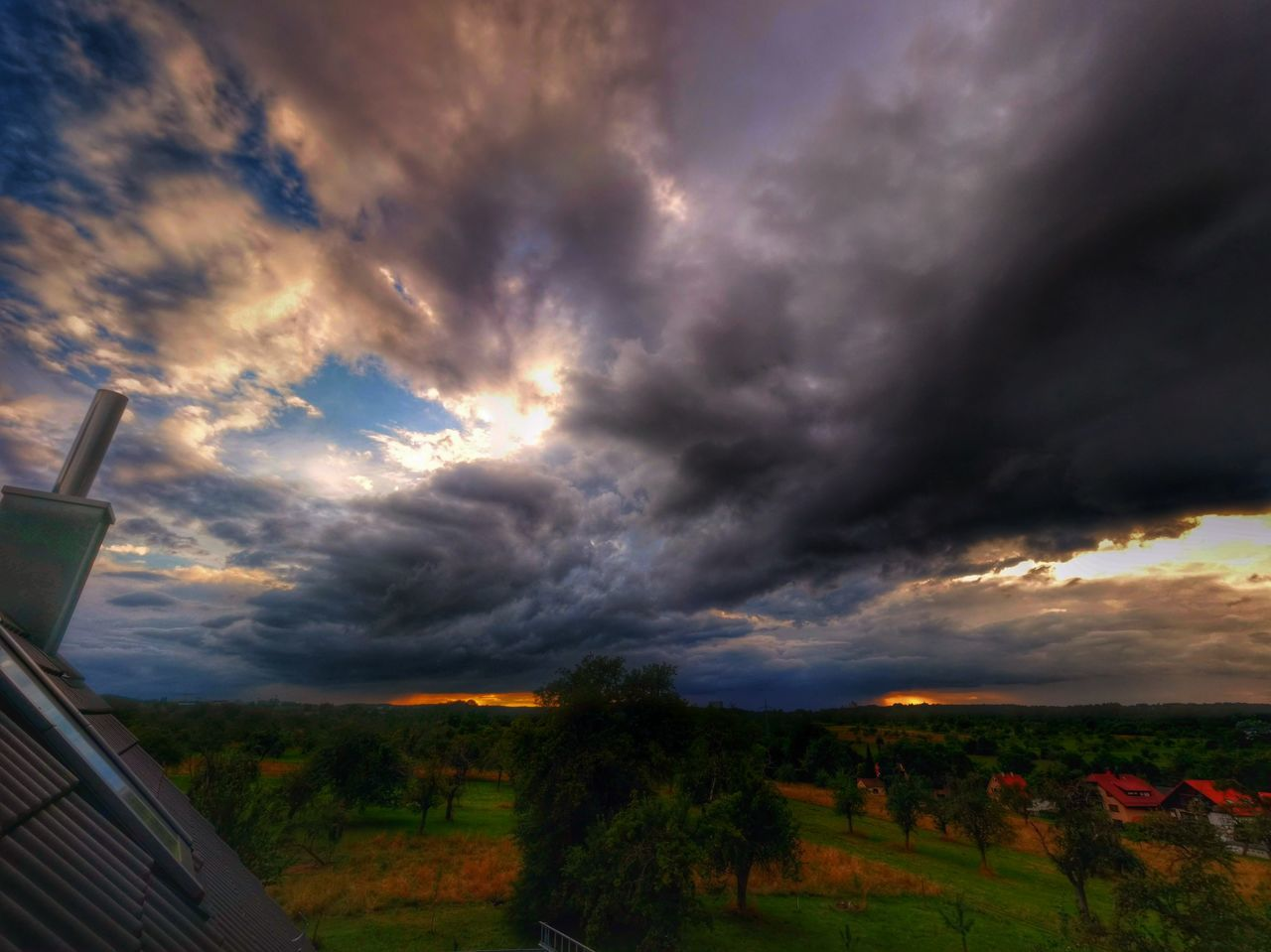 cloud - sky, sky, nature, dramatic sky, scenics, beauty in nature, no people, tranquility, tranquil scene, outdoors, sunset, storm cloud, landscape, tree, day, grass