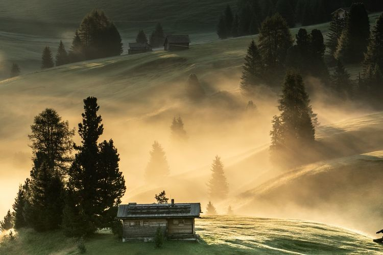 High angle view of house on landscape during foggy weather