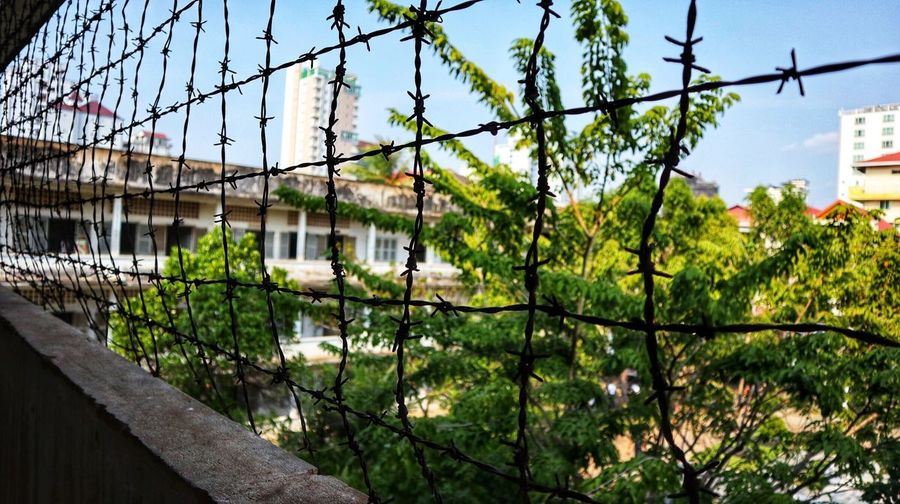 Tuol sleng genecide museum Minimalism Backpacker Backpack Travel Photography Travel Destinations Travel Barbed Wire EyeEmNewHere EyeEm Best Shots EyeEm Cambodia Genocide Museum Architecture Growth Day Outdoors No People Sky Plant Building Exterior Built Structure Nature Tree