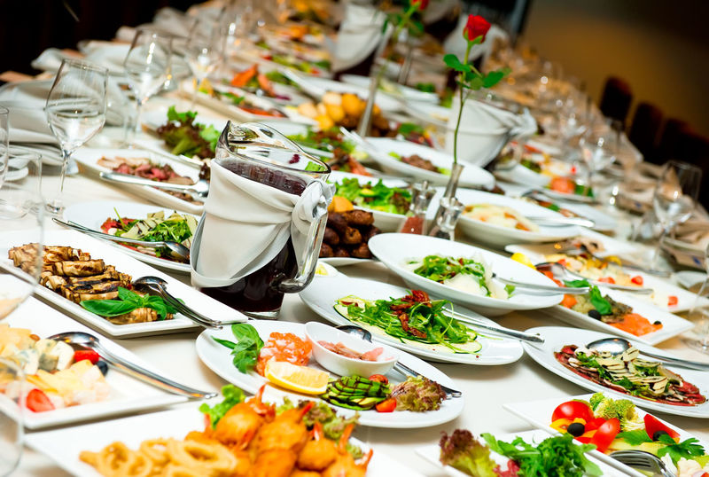 Table with food and drink Banquet Celebration Dishware Eating Salads Table Setting Table Arrangements Wedding Appetizer Appetizers Banquet Dinner Banquet Table Celebration Event Food Indoors  Main Course Meat And Fish No People Nobody Party Prepared Food Ready-to-eat Restaurant Restaurant Food Table