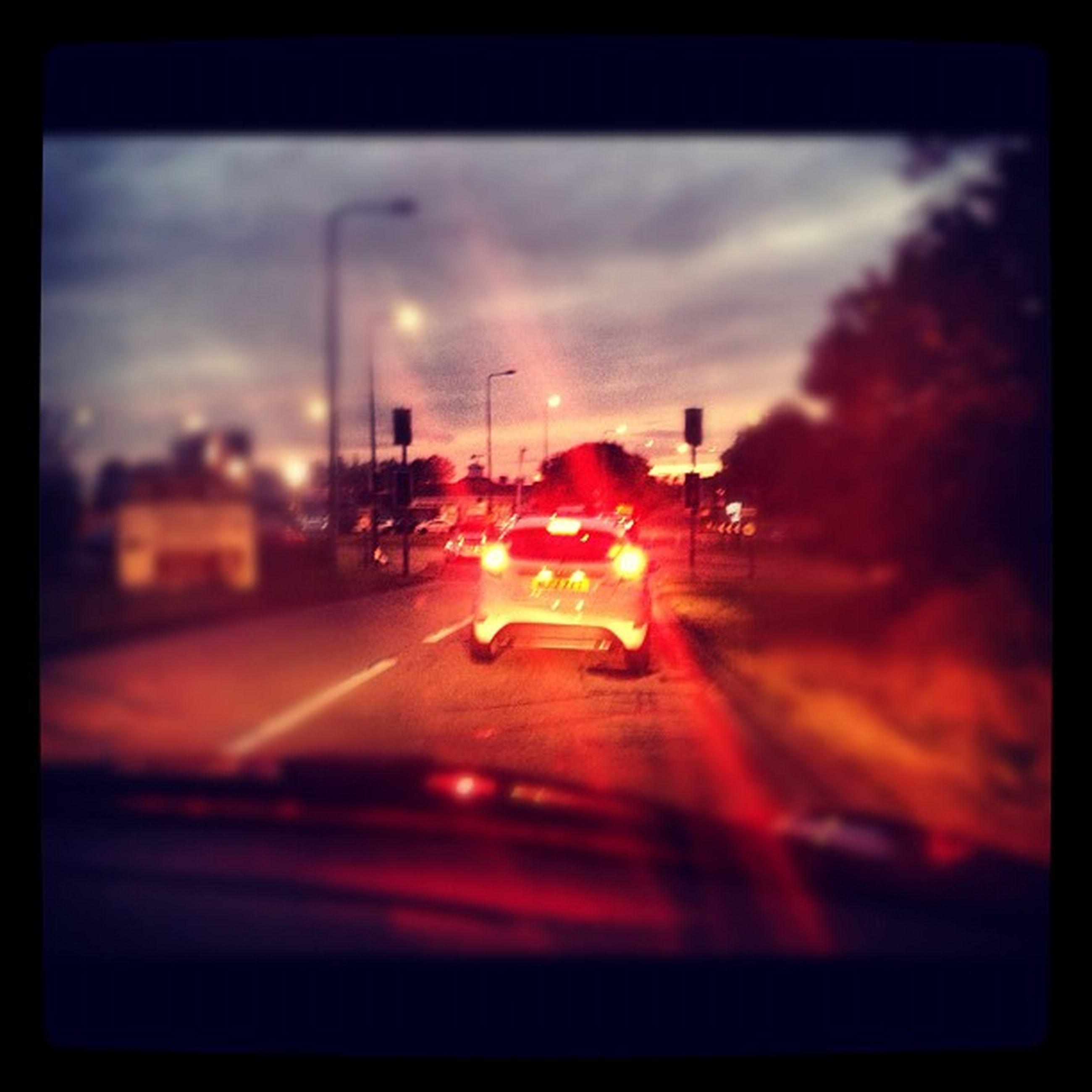 transfer print, auto post production filter, illuminated, transportation, sky, mode of transport, sunset, night, car, street, lighting equipment, selective focus, land vehicle, indoors, street light, road, lens flare
