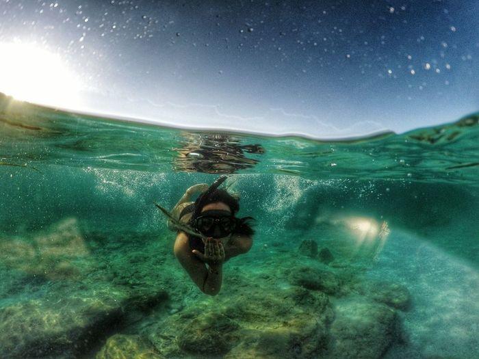 Portait Of Woman Snorkeling In Sea