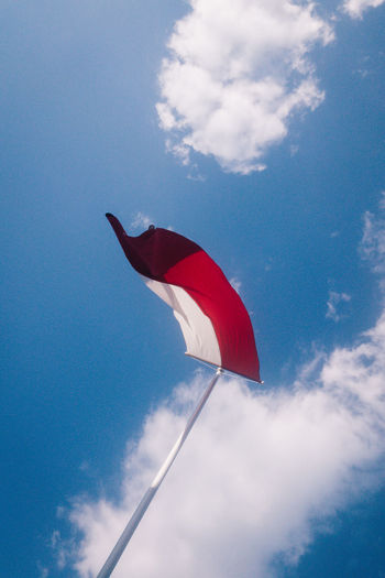 Blue Cloud - Sky Day Environment Flag Flying Freedom Low Angle View Mid-air National Icon Nature No People Outdoors Patriotism Pole Red Sky Striped White Color Wind