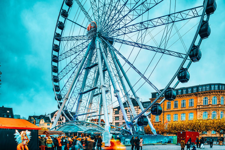 Low angle view of ferris wheel in city
