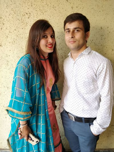 Two People Looking At Camera Togetherness Young Adult Smiling Portrait Standing Young Women Couple - Relationship Three Quarter Length Young Men Emotion Bonding Love Heterosexual Couple Happiness Casual Clothing Women Front View Young Couple Positive Emotion Boyfriend Hairstyle Arm Around Teenager