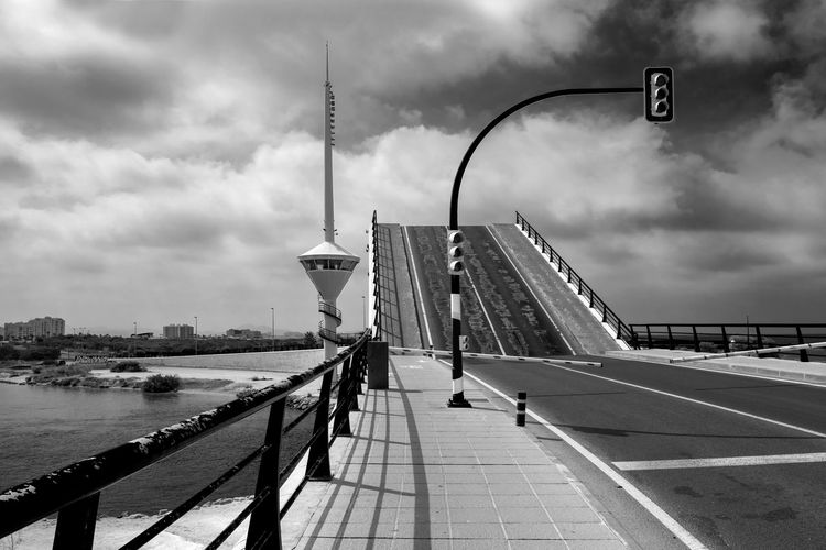 Panoramic view of drawbridge over city against sky