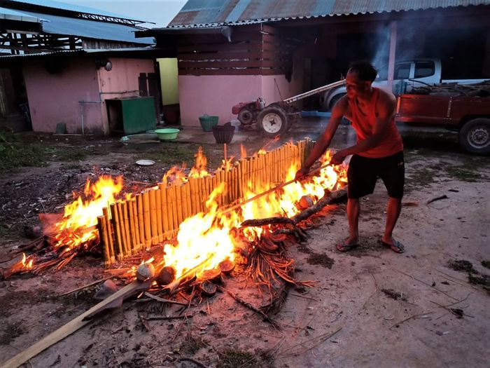 Full length of man working on fire