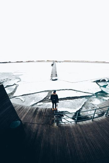 Aroud Alone Ice Water Clear Sky Copy Space Full Length Real People Men Walking Rear View Outdoors Day Sea Horizon Over Water Scenics Beauty In Nature Sky Lifestyles One Person Nature Standing People