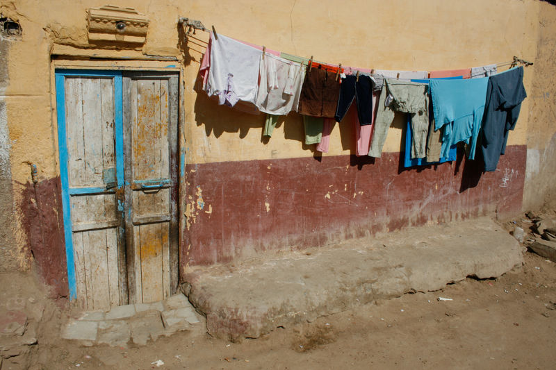House Textile Day Egypt Old Building Exterior Laundry Residential District Wall - Building Feature Outdoors Wall No People Clothesline Built Structure Drying Hanging Clothing Architecture Building Door