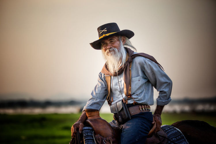 Senior man sitting on horse