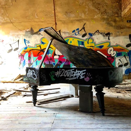 abandoned piano Art And Craft Graffiti Creativity Multi Colored Built Structure Wall - Building Feature Day Street Art Architecture Wall