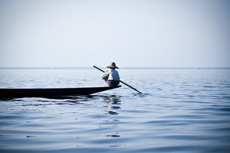 Man rowing on boat