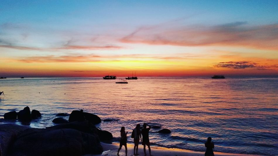 Sunset on Sairee Beach Sunset Sea Beach Beauty In Nature Outdoors Scenics Cloud - Sky Tranquility People Sky Nature Horizon Over Water Water Adult Human Body Part Day EyeEmNewHere