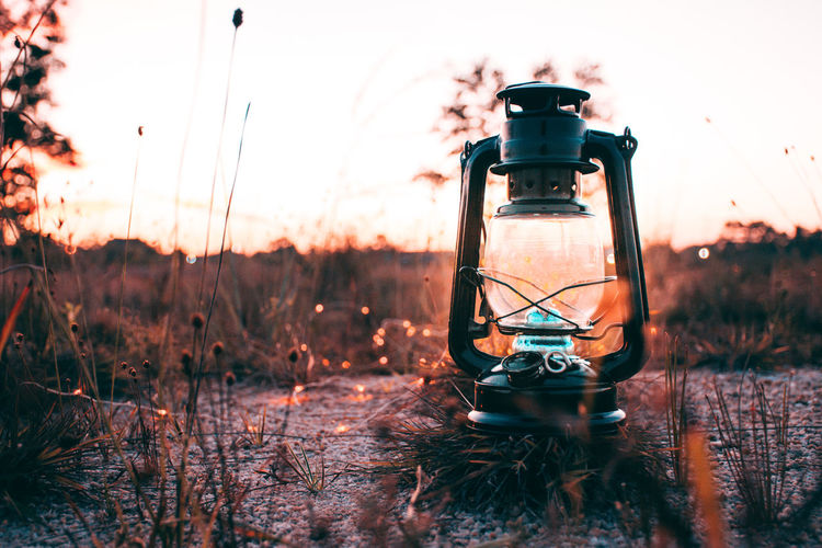 Love is letting go of fear. Land Sunset Field Nature Sky No People Plant Focus On Foreground Technology Oil Lamp Lighting Equipment Selective Focus Outdoors Lantern Day Grass Orange Color Single Object Electric Lamp