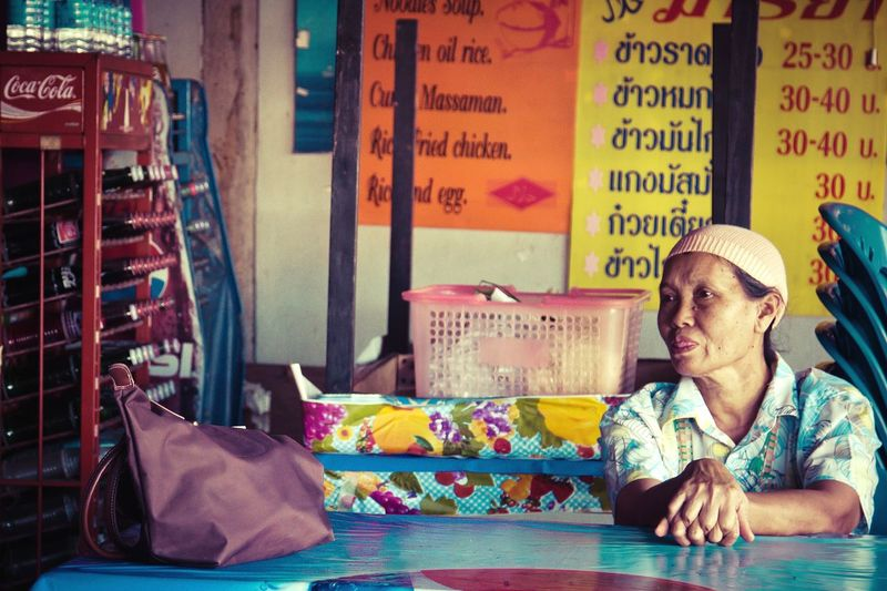 Investing In Quality Of Life One Person Adult Adults Only People Sitting Business Occupation Day City Indoors  Woman Power Indoors  Working Indoors  Real People Woman One Mature Woman Only Adults Only Adult Only Women Thailand Thailandtravel Thailand Trip Laundry Time