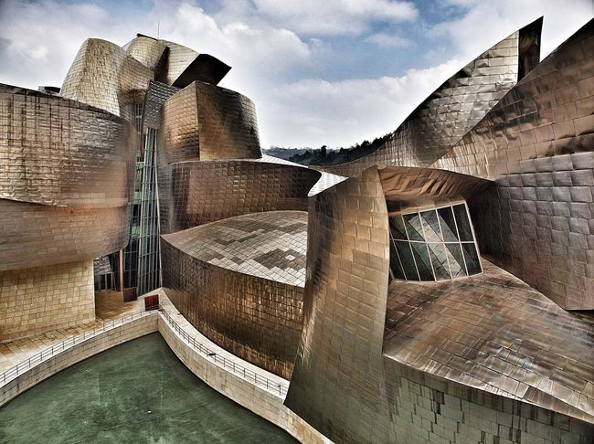 Guggenheim's back door. Architecture Bilbao Building Exterior Built Structure Cloud - Sky Cloudy E-M1 Euskadi Guggenheim Guggenheim Bilbao Museum No People Olympus Olympus OM-D EM-1 OM-D Sky SPAIN