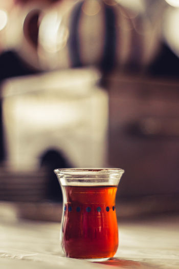 Close-up of tea in glass jar on table