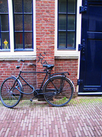 Bicycle Series Bicycle Brick Wall Building Exterior Built Structure City Day Mode Of Transport No People Outdoors Stationary Transportation Window Architecture_collection Street Photography Wall - Building Feature Cycling Photography Street Life Cycling Wall - Building Feature Street Photography EyeEmBestShots Red Land Vehicle Motion