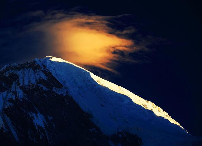 Snowcapped Mountain Peak At Dawn