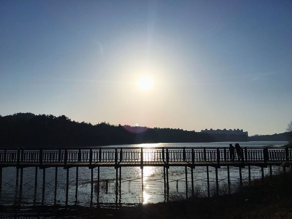 Sun Sunlight Sunset Water Railing Beauty In Nature Sky Nature Tree Outdoors Reflection Tranquility Silhouette Tranquil Scene Clear Sky Scenics No People Lake Day Architecture