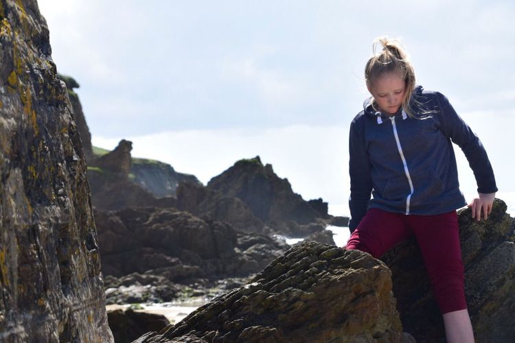 Rock - Object Real People One Person Leisure Activity Lifestyles Outdoors Day Sky Casual Clothing Nature Full Length Young Women Young Adult Climbing Standing Cornish Coast Cornwall Uk Sea Cornish Landscape Rock Climbing Wave Beach Photography Beach Life People