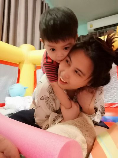 Cute baby girl with toy at home