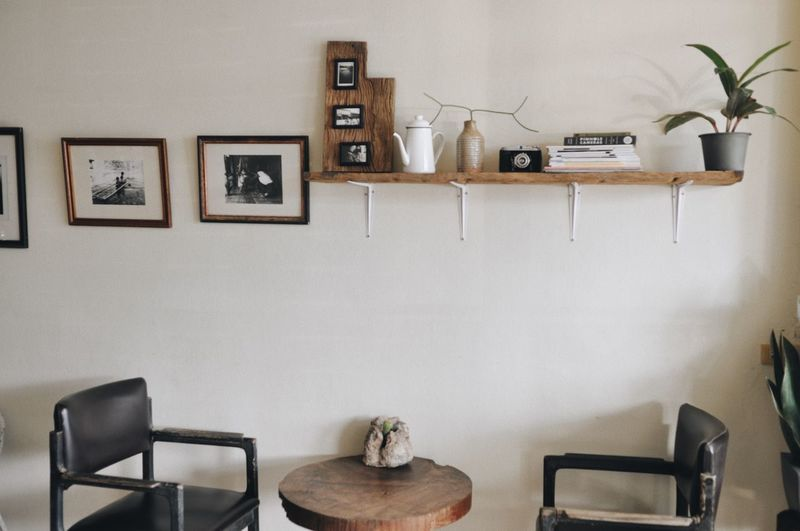 Cafe Wall - Building Feature Indoors  Seat Table Potted Plant No People Chair Plant Domestic Room Home Interior Picture Frame Living Room Wall Wood - Material Frame Furniture Absence Nature Built Structure Architecture