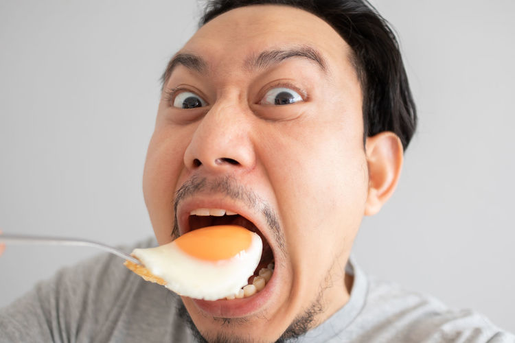 Close-up portrait of man eating food