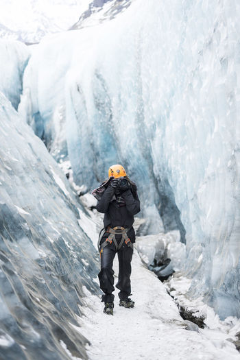 Iceland Adventure Backpack Beauty In Nature Climbing Cold Temperature Danger Day Frozen Full Length Glacial Glacier Headwear Ice Mountain Nature One Person Outdoors Photographer RISK Snow Standing Warm Clothing Waterfall Winter