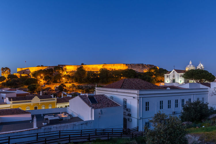 Castle of Castro Marim, Algarve, at sunset Building Exterior Architecture Built Structure Building Sky Tree Nature Clear Sky No People Plant City Residential District House Blue Copy Space Roof Place Of Worship Religion Belief High Angle View Outdoors Portugal Algarve Castro Marim Clear Sky