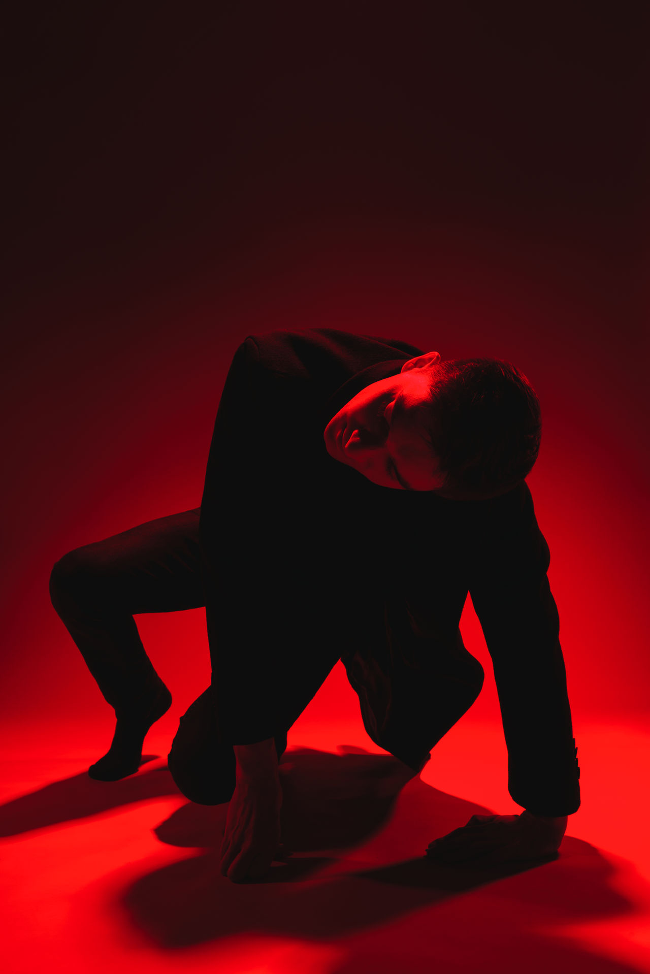 Man posing against red background