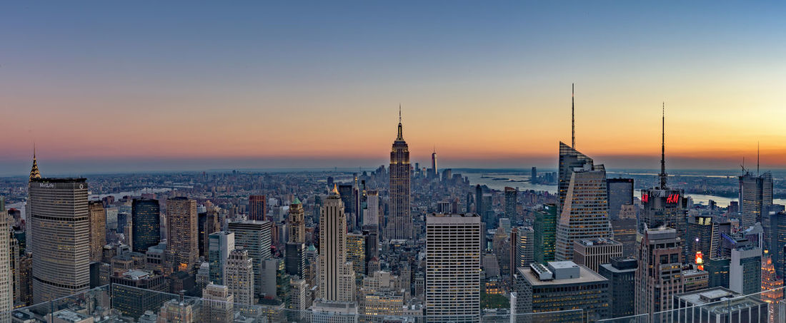 """(repost) Looking south over the city, the skyline of Manhattan looked enchanting during sunset. (Nikon D810 ƒ/18 24mm 0.8"""" iso 64) Architecture Landscapes With WhiteWall City City Life Cityscape Clear Sky Copy Space EyeEm Best Shots High Angle View High Definition Landscape Manhattan Modern New York New York City Office Building Panorama Sharp Sky Skyline Skyscraper The Architect - 2016 EyeEm Awards Urban Skyline Www.benjaminvanderspek.com"""