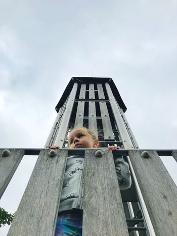 Ella Playground Real People One Person Sky Childhood Child Low Angle View Architecture Leisure Activity Day Cloud - Sky Standing Outdoors Portrait Girls Innocence Ladder Built Structure