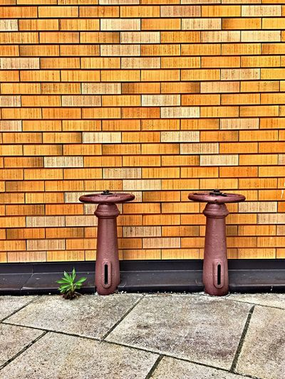 Valves against brick wall