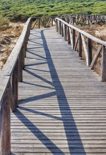 Wooden walkway along the beach in Bolonia, Spain Beachside Boardwalk Board Walk To Beach Boardwalk And Shadows Footbridge Shadows On Boardwalk Wooden Bridge Beachside Beauty In Nature Board Walk Boardwalk Boardwalk Photography Bolonia Beach Day Footbridge Nature No People Outdoors Railing Shadow Sunlight The Way Forward Wood - Material Wood Paneling Wooden Structure Wooden Walkway