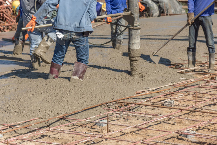 Working Real People Outdoors Construction Industry Group Of People Street Concrete Floor Workers Man Steel Pouring Ready Road