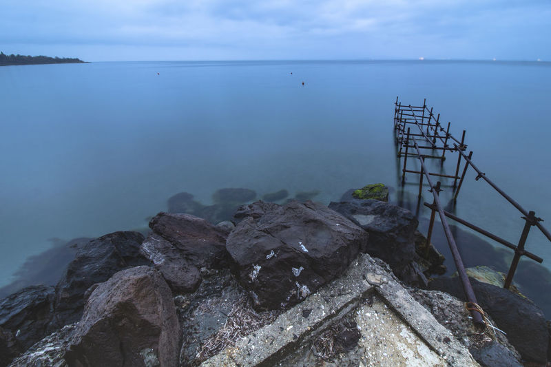 The Blue Hour. Water Sea Tranquility Sky Tranquil Scene Scenics - Nature Beauty In Nature Nature Horizon Cloud - Sky Rock Horizon Over Water Day No People Solid Idyllic Rock - Object Outdoors Non-urban Scene