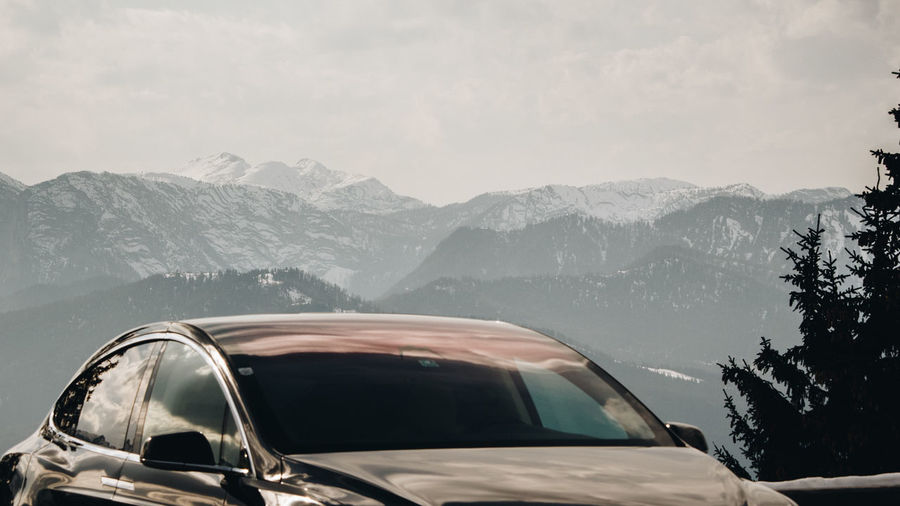 Car in mountains against sky
