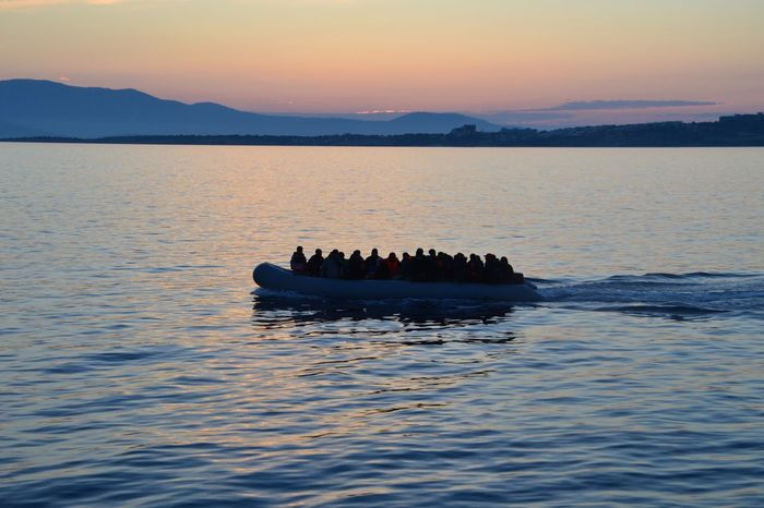 Trying to escape Childs Humans Hopeless Hope Last Hope Sadnes Escape On Sea Migration Migrants İrregular Migrants Inflatable Boat Inflatable  Sunset Nature Beauty In Nature Scenics Silhouette Water Mountain Sea Waterfront Outdoors Tranquility Sky Nautical Vessel AI Now Mobility In Mega Cities
