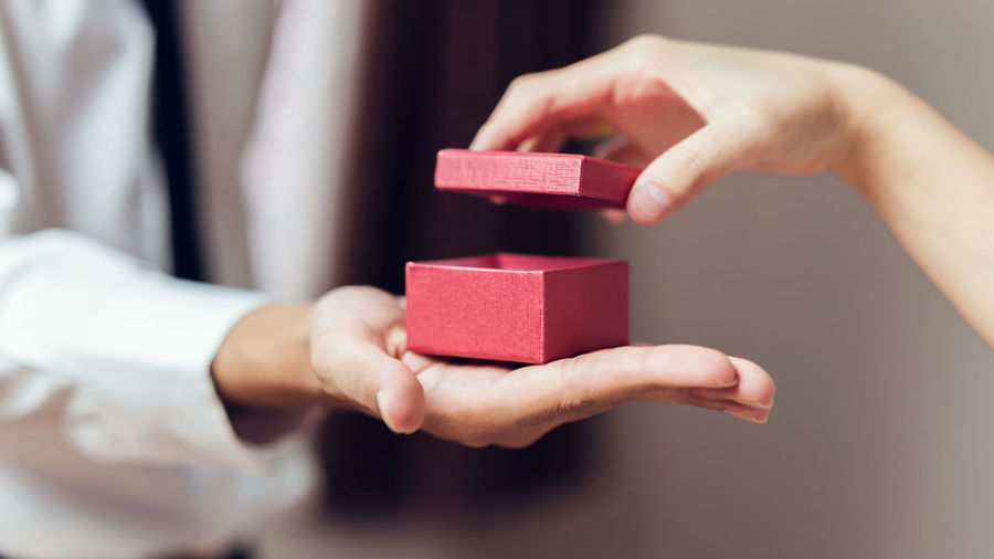Man holding open the empty red gift box. Human Hand Hand Human Body Part Indoors  Holding Focus On Foreground Adult Close-up Midsection Women Business People Toy Block Giving Corporate Business Toy Body Part Men Human Limb