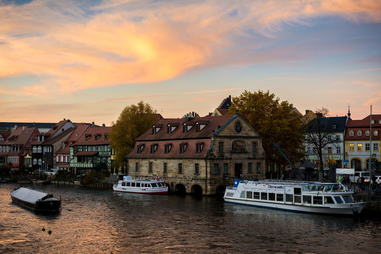 Buildings By River Against Sky During Sunset At Bamberg