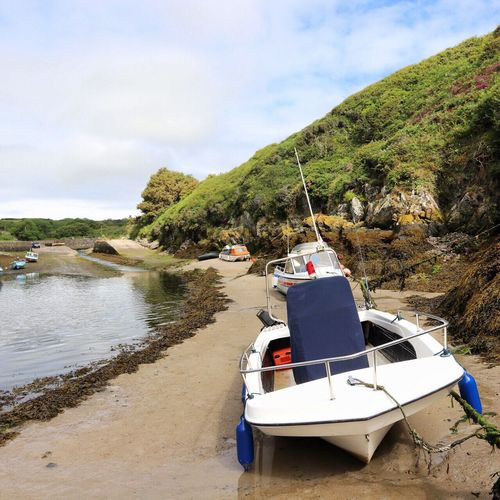 Sky Transportation Beach Water Mode Of Transport Day Sea Outdoors Nautical Vessel Nature No People Mountain Moored Sand Tree Beauty In Nature Harbour Pembrokeshire Porthclais Wales