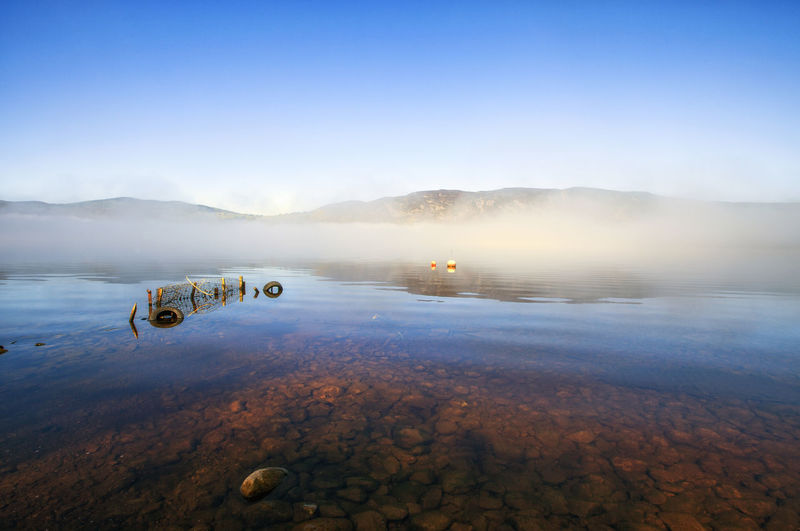 Panoramic view of Loch Ness in early foggy morning, Scotland, UK Beauty In Nature Blue Day Fog Lake Landscape Loch Ness Lochness Mystery Nature Nautical Vessel Ness No People Off-road Vehicle Outdoors Scenics Scotland Sky Sunset Tranquility Transportation Travel Uk Water