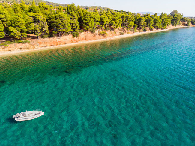 Vessel in calm waters Beatiful Nature Beauty In Nature Blue Chalkidiki Idyllic Land Mode Of Transportation Nautical Vessel Outdoors Pine Tree Scenics - Nature Sea Tranquil Scene Tranquility Tree Turquoise Colored Water Waterfront