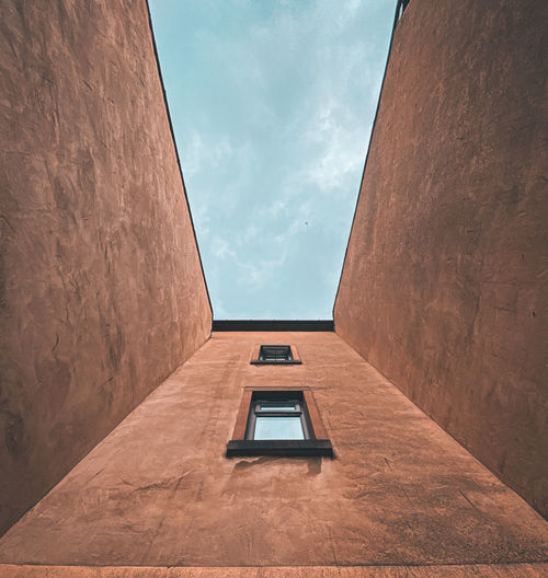 Minimalist, low angle view of building against sky