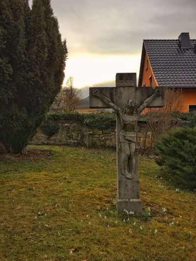 Stone cross with Jesus Christ View Views Sky Grass No People Built Structure Religion Cross Outdoors Nature Building Exterior Tree Spirituality Architecture Day Jesus Jesus Christ Grave Graveyard Graveyard Beauty Gravestone Graveyard Collection Graves Snowdrop Snowdrops