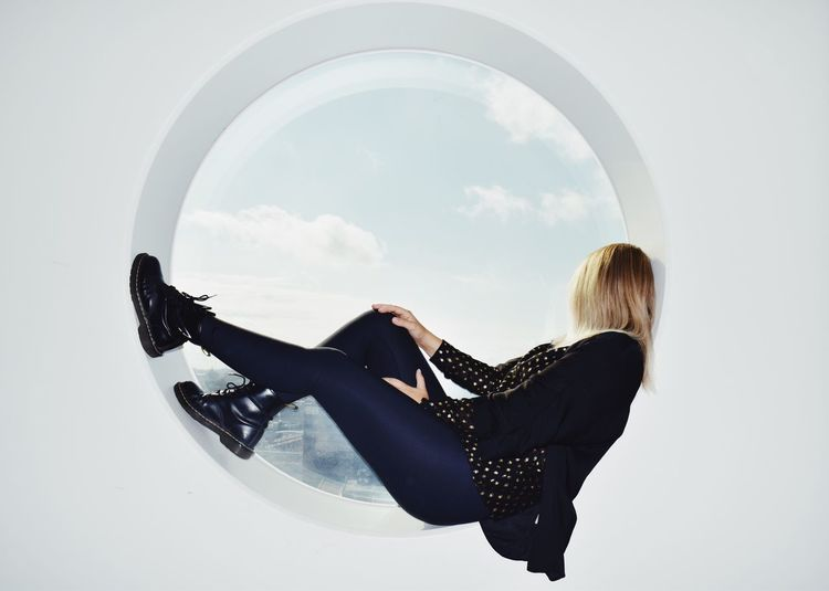 Geometric Shape Window One Person Full Length Real People Leisure Activity Sky Lifestyles Women Indoors  Side View Casual Clothing Cloud - Sky Sitting Architecture Circle Arch