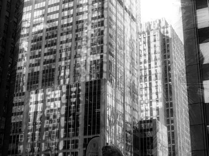 Architecture Skyscraper Building Exterior Built Structure City Modern Window City Life Low Angle View Day Outdoors No People Corporate Business Urban Geometry Blackandwhite Sunny Day Shadow And Light Streetphotography