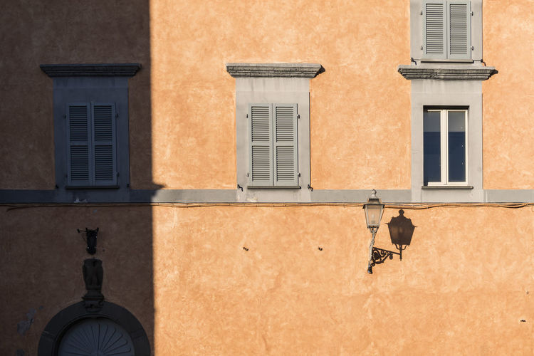 Orvieto, Italy Building Exterior Window Built Structure Architecture Building Residential District No People Day Low Angle View Sunlight Outdoors Wall - Building Feature Shadow Nature Lighting Equipment City Street Light House Street Old Electric Lamp The Architect - 2019 EyeEm Awards