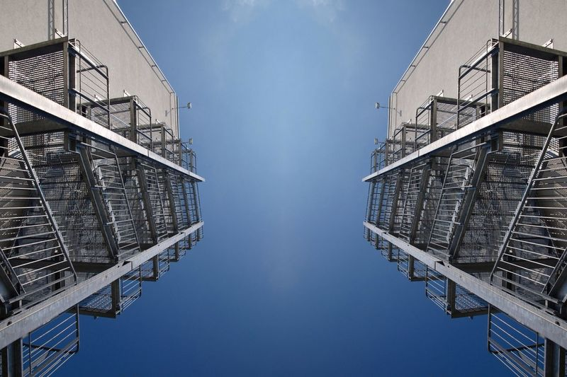 Low angle view of fire escapes on the outside of buildings